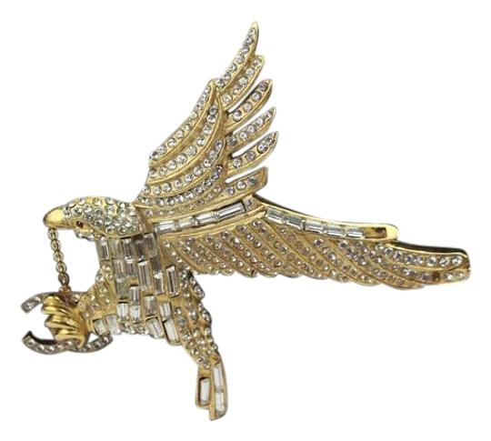 Preload https://img-static.tradesy.com/item/19257067/chanel-gold-and-crystal-eagle-brooch-with-cc-charms-0-1-540-540.jpg