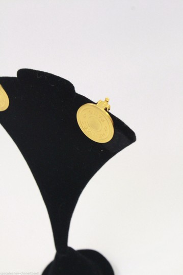 Hermès Gold Button Signature Earrings Clip On