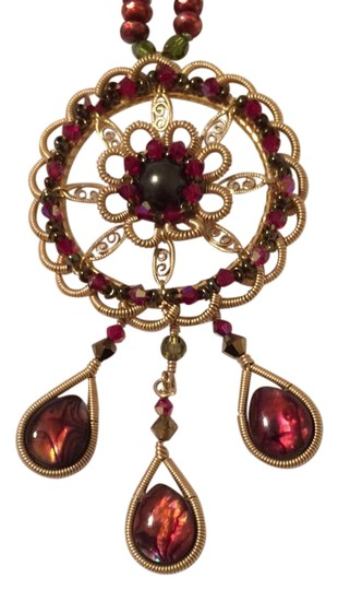 Preload https://img-static.tradesy.com/item/19259845/miguel-ases-cranberrygoldtone-beaded-with-pendant-necklace-0-1-540-540.jpg