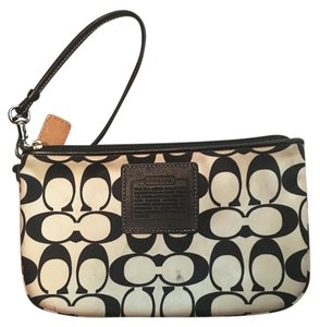 Coach Monogram Classic Wristlet in black and white