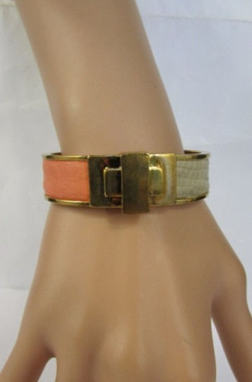 Preload https://item3.tradesy.com/images/bcbg-women-bracelet-gold-metal-fashion-cuff-coral-ivory-gray-faux-snake-leather-1928747-0-0.jpg?width=440&height=440