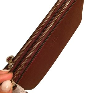 Coach Wristlet in Maroon