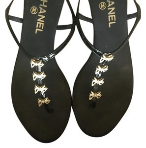 Chanel Black with gold Sandals