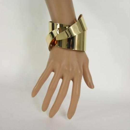 Preload https://item5.tradesy.com/images/women-shiny-gold-twisted-metal-cuff-wave-bracelet-fashion-jewelry-chic-1931609-0-0.jpg?width=440&height=440