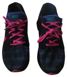 Nike Black sole with pink laces and a blue and black mix base. Very trendy. Athletic