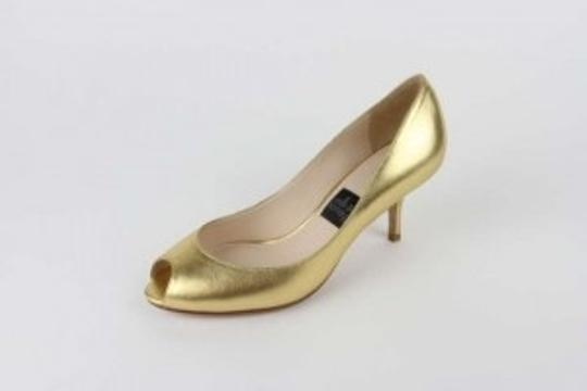 Preload https://item5.tradesy.com/images/milk-and-honey-gold-formal-shoes-size-us-7-193409-0-0.jpg?width=440&height=440