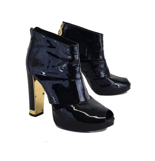 Preload https://img-static.tradesy.com/item/19354283/tory-burch-black-patent-leather-heels-sandals-size-us-65-regular-m-b-0-0-540-540.jpg