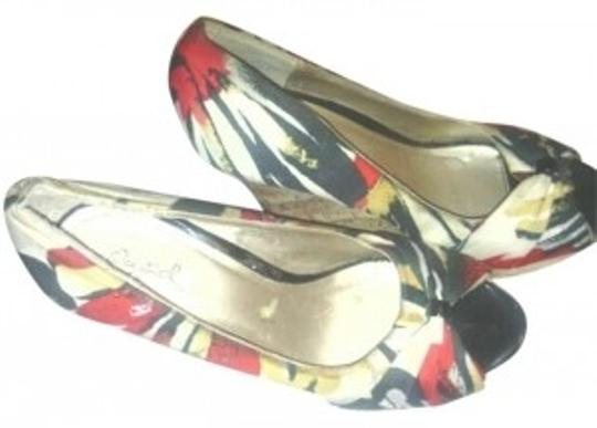 Preload https://item4.tradesy.com/images/qupid-red-yellow-white-and-black-wedges-size-us-7-193543-0-0.jpg?width=440&height=440