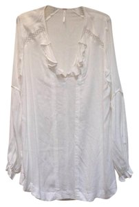 Free People short dress White V-neck Tunic Ruffle on Tradesy