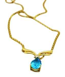 Bullion & Diamond Co. Swiss Blue Topaz, Blue Stone Jewelry, 14k Gold Pendant and Chain