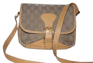 Gucci Bold Gold Accents High-end Bohemian Restored Lining Unique Brown Shades Excellent Condition Cross Body Bag