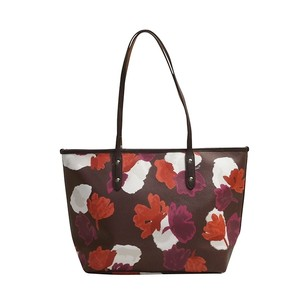Coach Tote in Foloral oxblood Gold
