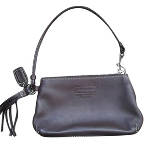Coach Wristlet in Brown leather with tassel