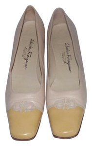 Salvatore Ferragamo Comfy Classic Dressy Or Casual Spectator Style Gancini Accent Heel ivory and yellow leather Pumps