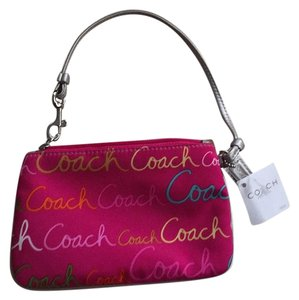 Coach Wristlet in Hot Pink With Multicolored Detail.