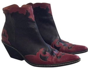 Donald J. Pliner Black leather with red trim design Boots