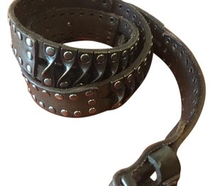 Dark green leather belt with rivet and silver hardware details