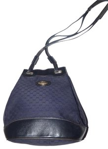 ff84d41fd27671 Gucci Gold Hardware Has Fobs Nautical Look Drawstring Top Satchel in navy  blue small G logo