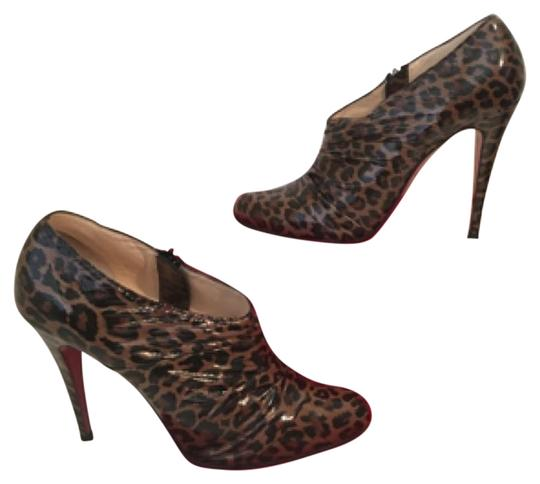 Preload https://img-static.tradesy.com/item/19404107/christian-louboutin-leopard-ruched-patent-leather-booties-405-pumps-size-us-9-regular-m-b-0-1-540-540.jpg