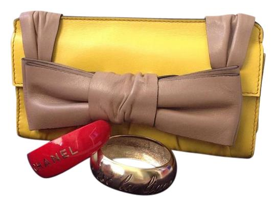 Preload https://img-static.tradesy.com/item/19424656/valentino-lamb-s-skin-yellow-leather-clutch-0-1-540-540.jpg