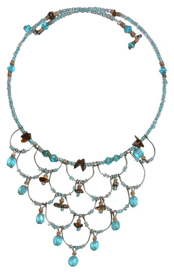 Preload https://item5.tradesy.com/images/light-blue-and-silver-tone-boho-chic-necklace-1942934-0-0.jpg?width=440&height=440