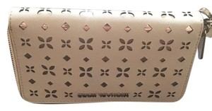Michael Kors Perforated Silver Wristlet in white