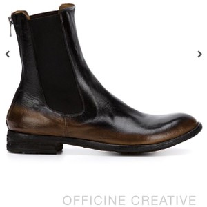 Officine Creative OFFICINE CREATIVE CAFE-NERO LEXIKON/073 ANKLE BOOT The Officine Creative Cafe-Nero Lexikon/073 Ankle Boot is a beautifully made leather boot with a patina lending a vintage air to the otherwise modern style. Boots