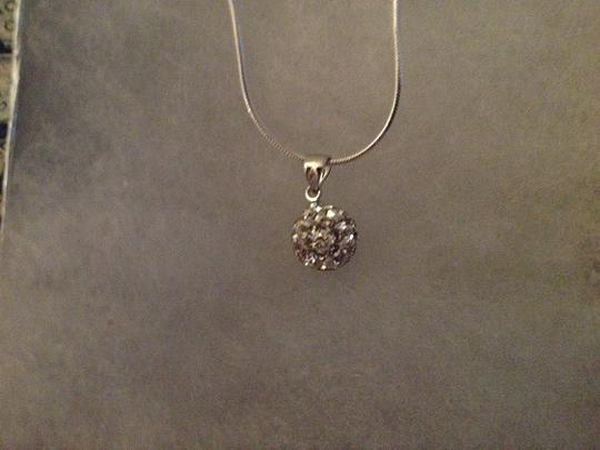 "Penny's Jewelry Sterling Silver 16"" Snake Necklace with small CZ Disco Ball Pendant. Adorable at the curve of the neck!"