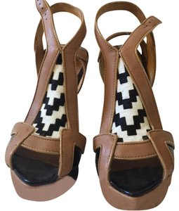 L.A.M.B. Black, tan, white Platforms