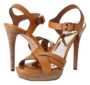 Coach Leather. Imported. Measurements: Heel Height: 4 12 In Weight: 9 Oz Platform Height: 1 14 In Natural Sandals