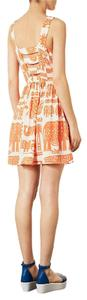 Topshop short dress Orange Tribal/Animal Print Skater Tribal on Tradesy