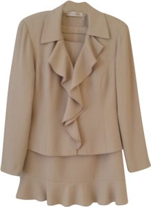 Ildi Marshall Two piece polyester suit with ruffled neckline and ruffled hem line.