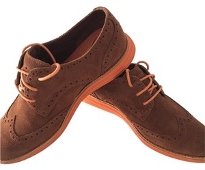 Cole Haan Brown suede with orange sole and laces Flats