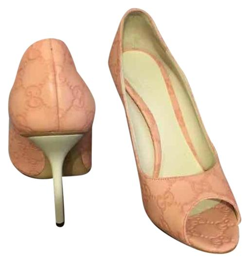 Preload https://item1.tradesy.com/images/gucci-rose-new-stiletto-peep-toe-heels-rare-color-w-gg-printed-on-them-12-formal-shoes-size-us-75-re-19497085-0-1.jpg?width=440&height=440