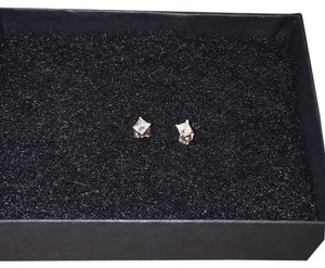 Pompeii3 This pair of diamonds studs features two princess square cut natural diamonds. The diamonds are prong set in solid 14k white gold and secured with 14k white gold push backs. 4 prong 1/4CT Princess Cut Diamonds 14K (F-G, I1-I2)