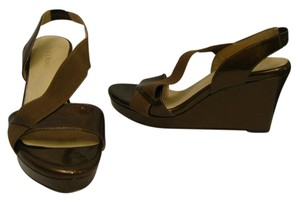 Taryn Rose metallic bronze Wedges