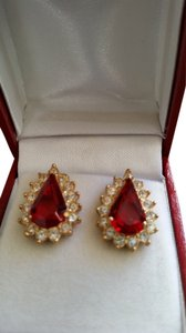 Gold tone red crystal and cubic zirconia earrings