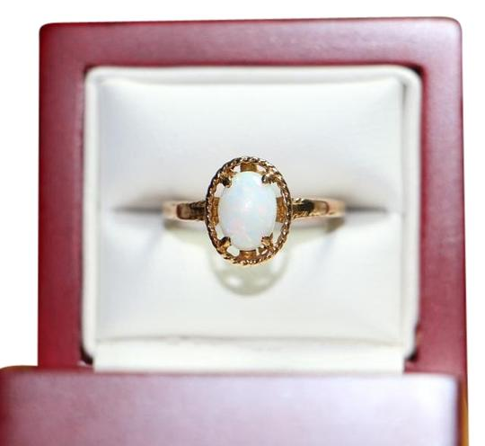 Preload https://img-static.tradesy.com/item/19510411/gold-10k-yellow-oval-opal-solitaire-2-grams-ring-0-1-540-540.jpg
