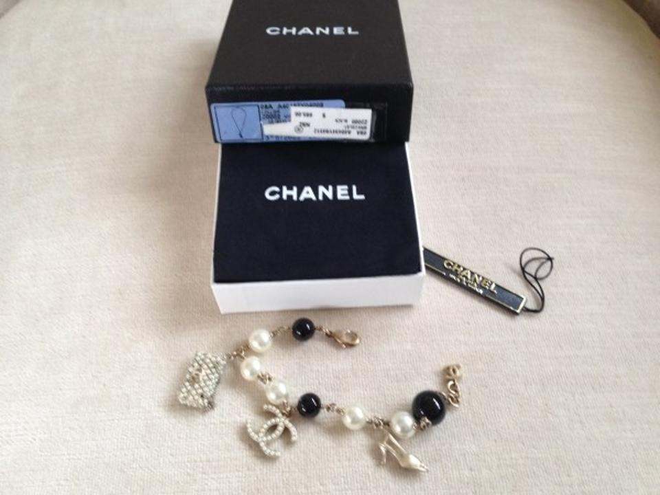 70851f561fb2 Chanel Chanel Bracelet with Black/White Pearls. Shoe, Chanel Logo and Pearl  Purse ...