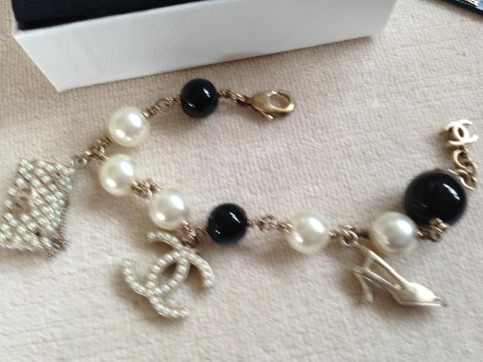 0ec3d0dd1baa Chanel Polished Gold Plate With Black/White Pearls. Shoe Logo and ...