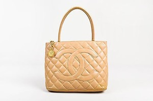 Chanel Quilted Caviar Leather Cc Logo Medallion Tote in Beige