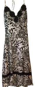 Sangria short dress Black And Cream on Tradesy