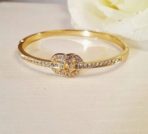 Other Radiant Gold Plated Infinity Bangle