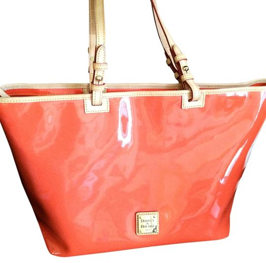 Preload https://item2.tradesy.com/images/dooney-and-bourke-like-new-leisure-shopper-orange-patent-leather-leather-tote-1953376-0-0.jpg?width=440&height=440