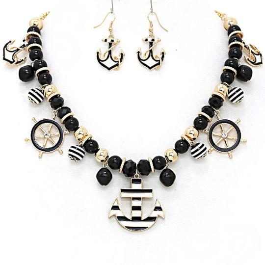 Preload https://item1.tradesy.com/images/black-white-and-gold-nautical-by-the-sea-stripe-anchor-bib-collar-earring-set-necklace-1954005-0-0.jpg?width=440&height=440