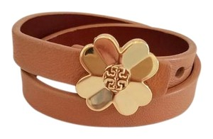 Tory Burch TORY BURCH LEATHER WRAP BRACELET TAN WITH GOLD FLOWER