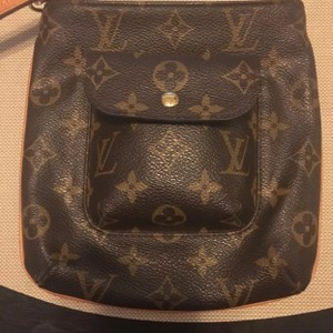 Louis Vuitton Wristlet in Monogram Brown