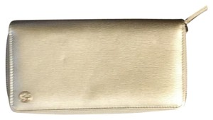 Gucci Gucci Metallic Gold Zipper Wallet
