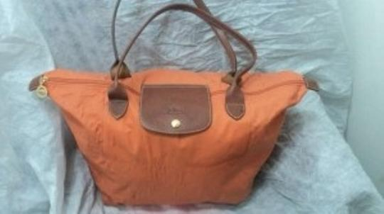 Preload https://img-static.tradesy.com/item/195432/longchamp-pliage-orange-canvas-leather-tote-0-0-540-540.jpg
