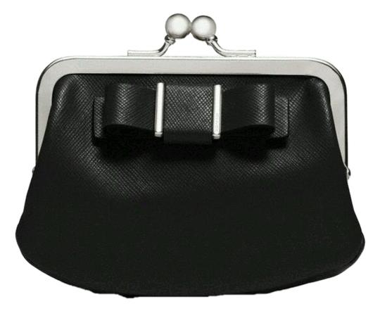 Preload https://item5.tradesy.com/images/coach-black-coin-purse-saffiano-leather-coin-darcy-bow-framed-coin-purse-wallet-1954749-0-0.jpg?width=440&height=440